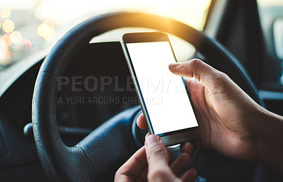 Buy stock photo Cropped shot of an unrecognizable woman using her smartphone while driving