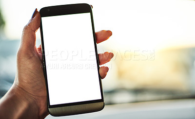 Buy stock photo Cropped shot of an unrecognizable woman holding up her smartphone