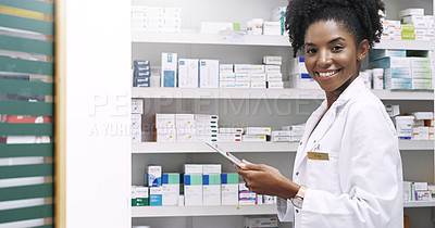 Buy stock photo Cropped portrait of an attractive  young pharmacist using a digital tablet in a chemist