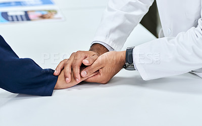 Buy stock photo Cropped shot of an unrecognizable pharmacist holding a customers hands in comfort inside of a pharmacy during the day