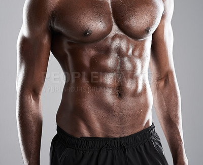 Buy stock photo Studio shot of an unrecognizable muscular man posing against a grey background
