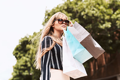Buy stock photo Shot of a beautiful and stylish young woman shopping in the city