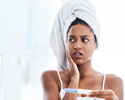 Buy stock photo Shot of a beautiful young woman taking a pregnancy test at home