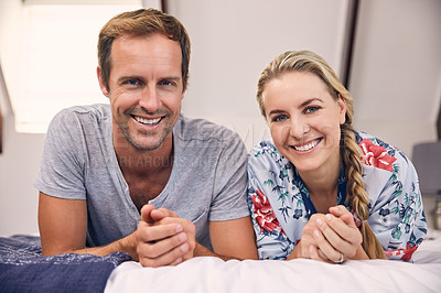 Buy stock photo Portrait of a beautiful young couple spending some time together at home
