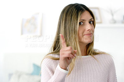 Buy stock photo Cropped shot of an attractive woman posing at home