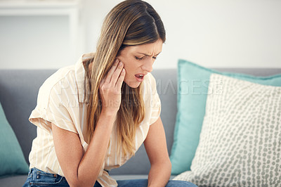 Buy stock photo Cropped shot of an attractive woman experiencing a toothache
