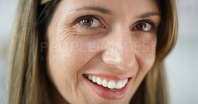 Buy stock photo Cropped shot of an attractive woman smiling at the camera