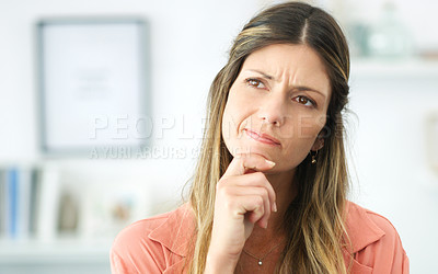 Buy stock photo Cropped shot of an attractive woman looking thoughtful
