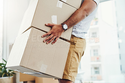 Buy stock photo Closeup shot of a man carrying a pile of boxes while moving house