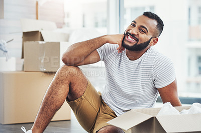 Buy stock photo Shot of a young man taking a break while moving house