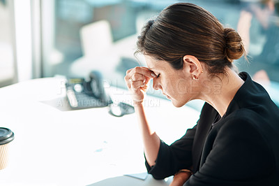Buy stock photo Shot of a businesswoman experiencing stress while working in a modern office