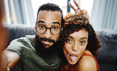 Buy stock photo Closeup shot of a young couple taking a selfie at home