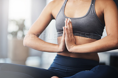 Buy stock photo Cropped shot of an unrecognizable young woman practicing yoga in her bedroom in the morning