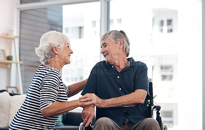 Buy stock photo Shot of a happy senior man in a wheelchair with with his wife at home
