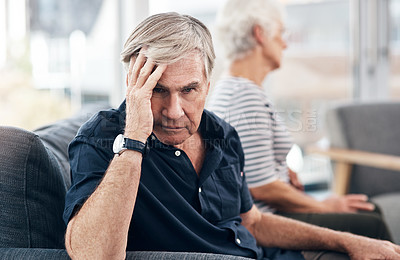 Buy stock photo Shot of a senior couple having a disagreement at home