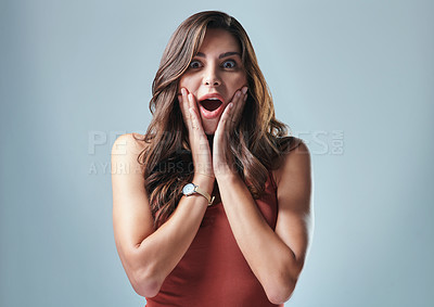 Buy stock photo Studio shot of a beautiful young woman looking surprised against a grey background