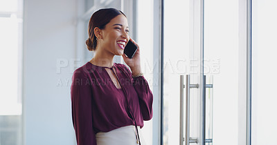 Buy stock photo Shot of a beautiful young businesswoman taking a phone call in her office