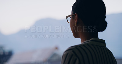 Buy stock photo Silhouetted shot of a young businesswoman looking at the view outdoors