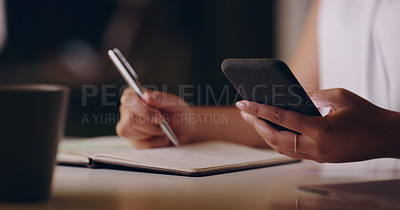 Buy stock photo Shot of an unrecognizable businesswoman holding a cellphone and writing notes down on paper while working late in her office
