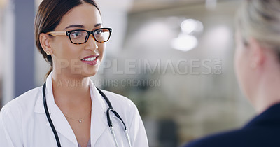 Buy stock photo Shot of a young doctor having a consultation with her patient