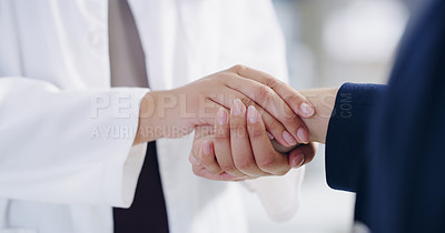 Buy stock photo Cropped shot of a doctor holding hands with her patient