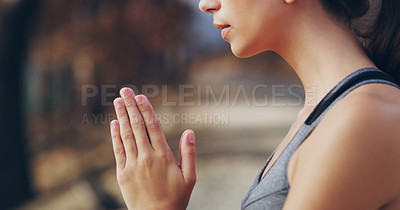 Buy stock photo Shot of a sporty young woman standing with her hands clasped