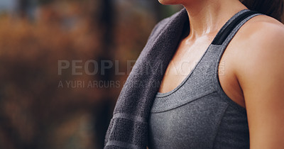 Buy stock photo Cropped shot of an unrecognizable young woman out for a run