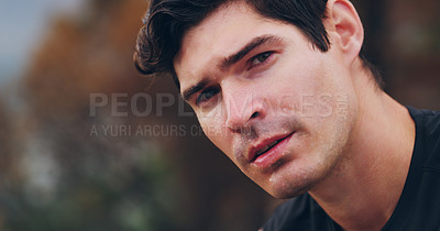 Buy stock photo Cropped shot of a young man sweating excessively after his run