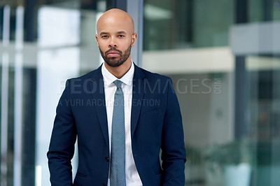 Buy stock photo Portrait of a handsome young businessman in his office