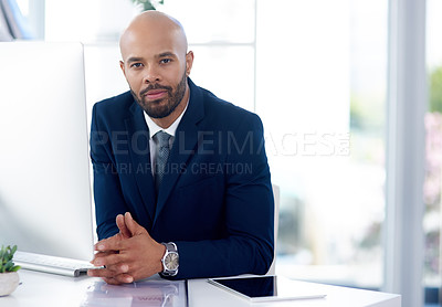 Buy stock photo Portrait of a handsome young businessman at his office desk