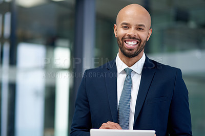 Buy stock photo Portrait of a handsome young businessman using a digital tablet in his office