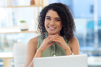 Buy stock photo Cropped portrait of an attractive young businesswoman looking thoughtful while working at her desk in the office