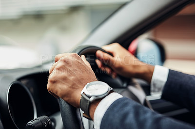 Buy stock photo Cropped shot of an unrecognizable man's hands on a steering wheel