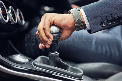 Buy stock photo Cropped shot of an unrecognizable man's hand on his gearstick while driving
