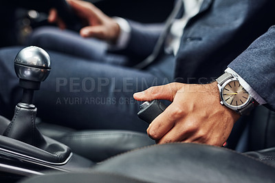 Buy stock photo Closeup shot of a driver holding on to the handbrake lever of a motor vehicle
