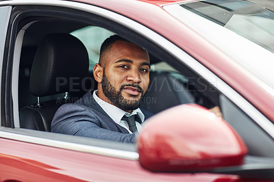 Buy stock photo Shot of a well dressed man driving a car