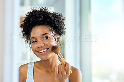 Buy stock photo Shot of an attractive young woman applying makeup during her morning beauty routine