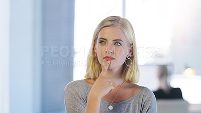 Buy stock photo Cropped shot of a confident young businesswoman contemplating while standing inside of the office at work