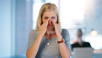 Buy stock photo Portrait of a stressed out young businesswoman wiping her tears away with her hands while standing inside of the office