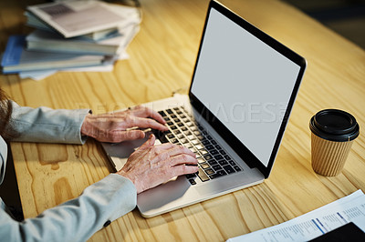 Buy stock photo Closeup shot of an unrecognizable businesswoman using a laptop in an office at night