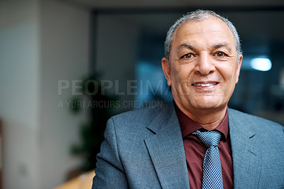 Buy stock photo Portrait of a mature businessman standing in an office at night