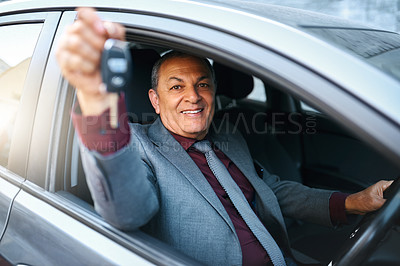 Buy stock photo Portrait of a mature businessman holding the keys to his new car