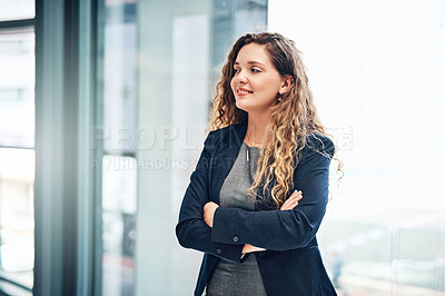 Buy stock photo Shot of a young businesswoman looking thoughtful in an office