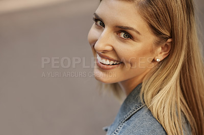 Buy stock photo Closeup portrait of an attractive young female student sitting alone on campus