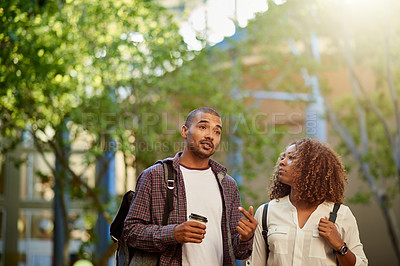 Buy stock photo Cropped shot of a young couple having a discussion while walking around campus