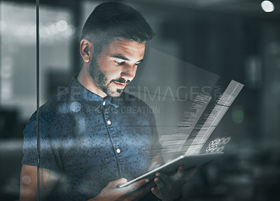 Buy stock photo Cropped shot of a handsome young businessman working on his digital tablet late in the office