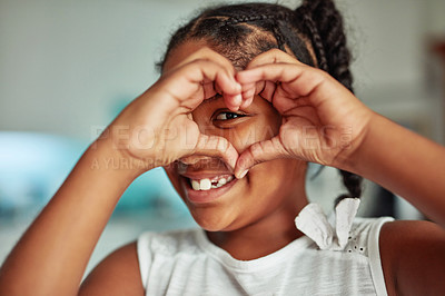 Buy stock photo Cropped shot of a young girl forming a heart shape with her hands