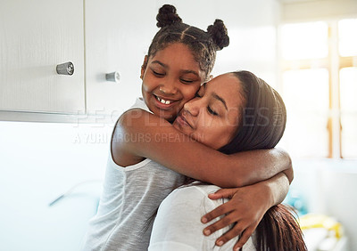 Buy stock photo Cropped shot of a little girl and her mother spending quality time at home