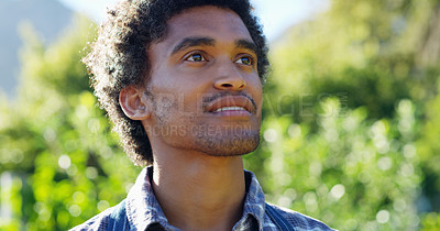 Buy stock photo Cropped shot of a handsome young male farmer looking thoughtful while working on his farm