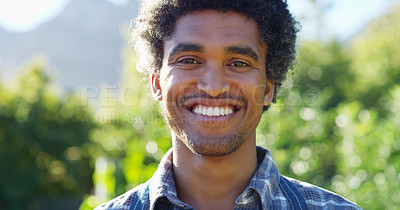 Buy stock photo Cropped portrait of a handsome young male farmer working on his farm